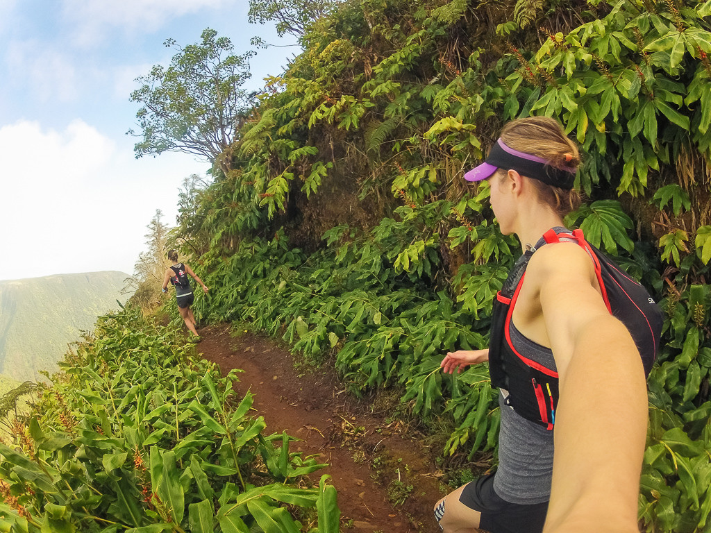 Running on the lush White Road trail near Waimea.