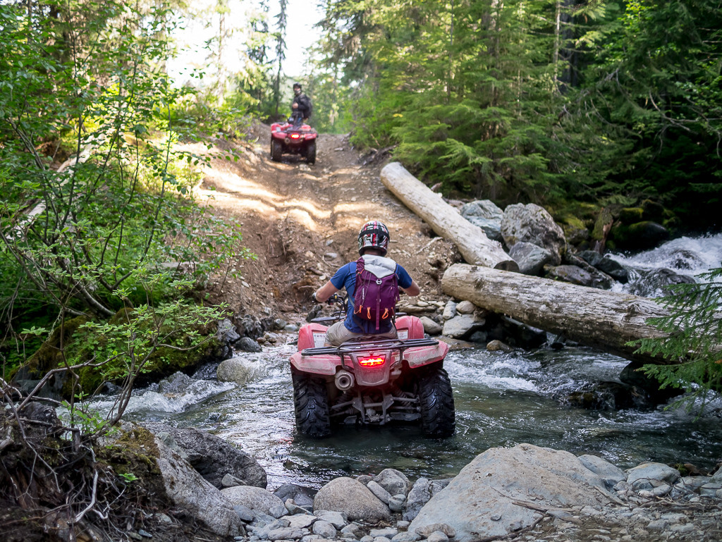 Tackling the creek crossing on our ATV