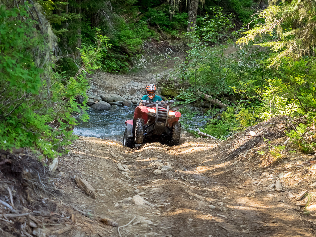 Crossing a creek on the rugged trails of the Callaghan Valley