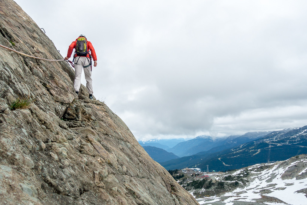 Traversing a section of rock on the Whistler Via Ferrata.