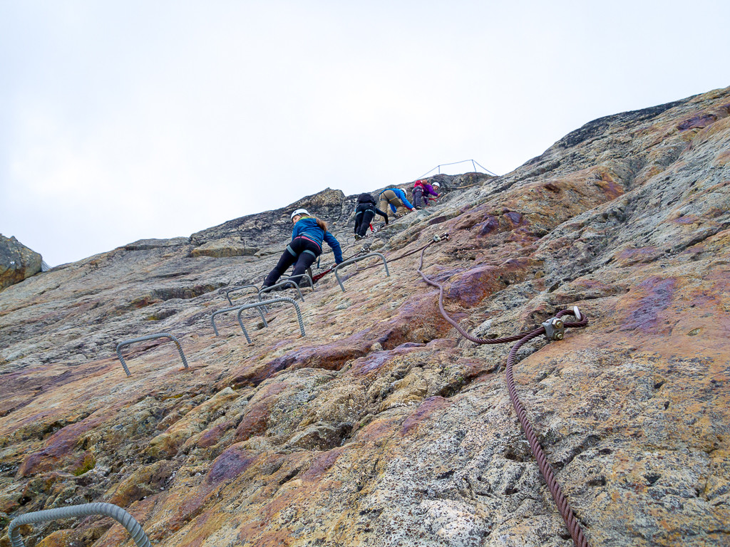 Climbing up a wall of rock on the Whistler Via Ferrata.