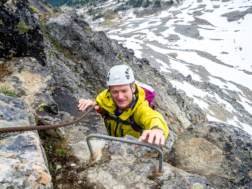 Reaching for one of the last rungs on the Whistler Via Ferrata.