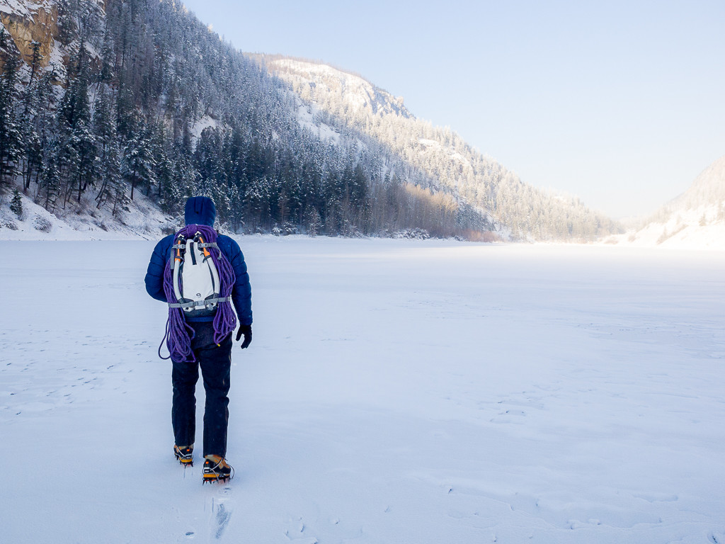 Crossing a frozen lake, with the SnoJo 20 packed for a day of Ice Climbing