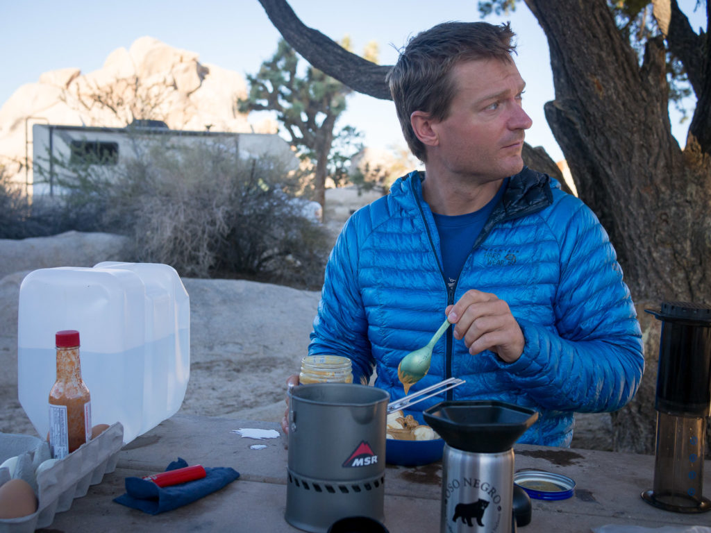 A chilly morning for camp breakfast in Joshua Tree with the Ghost Whisperer Down Jacket.